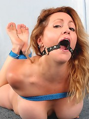 Busty milf hogtied and ball..