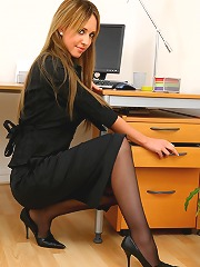 Blonde secretary slips out of..